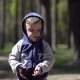The Child Wears Sunglasses In Spring Park - VideoHive Item for Sale