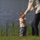Mother With Baby On The Shore Of The Lake - VideoHive Item for Sale