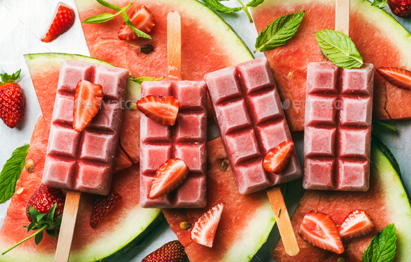 Strawberry watermelon ice cream popsicles with mint over steel tray background - Stock Photo - Images