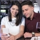 Woman Shows Something On Her Phone To Her Boyfriend - VideoHive Item for Sale