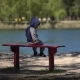 Child On The Bench By The Lake - VideoHive Item for Sale