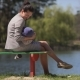 Mother With Baby On The Bench By The Lake - VideoHive Item for Sale