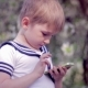Young Little Boy Plays Games On Smartphone - VideoHive Item for Sale