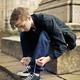 Boy ties his shoes - PhotoDune Item for Sale