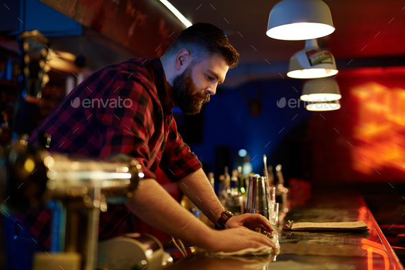 Barman by bar counter - Stock Photo - Images