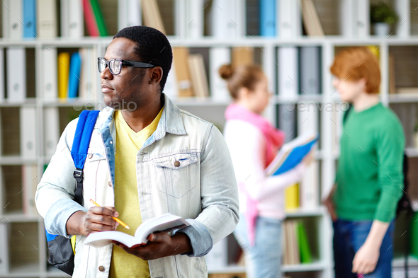 Student in library - Stock Photo - Images