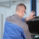 Mechanic Closes Car Hood At The Car Service - VideoHive Item for Sale