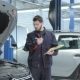 Mechanic Examines Car At The Service - VideoHive Item for Sale