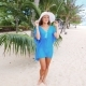 Beach Vacation. Hot Beautiful Woman In Sunhat And Bikini Standing With Her Arms Raised To Her Head Nulled