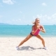 Fitness Sport Woman Doing Sporty Exercise  On Beach Outside At Sunset. Healthy Lifestyle Image Of Nulled
