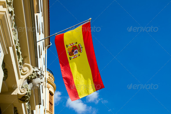 Spanish flag flying at an old building - Stock Photo - Images