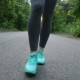 Girl in Green Sneakers Walking on the Road in Forest. Feet - VideoHive Item for Sale