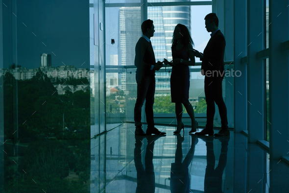 Chatting colleagues - Stock Photo - Images