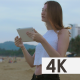 Girl Talking Using Tablet at Seaside - VideoHive Item for Sale