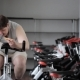 Thick Guy Practices On An Exercise Bike, Stopping To Eat Pizza And Continues To Train - VideoHive Item for Sale