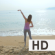 Young Woman Doing Exercises on the Beach - VideoHive Item for Sale