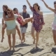 Group Of Young Friends Frolicking On a Beach - VideoHive Item for Sale