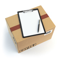 Delivery concept. Cardbox, pen and clipboard with receiving form - PhotoDune Item for Sale