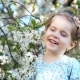 Little Girl Smelling The Cherry Flowers And Smiling - VideoHive Item for Sale