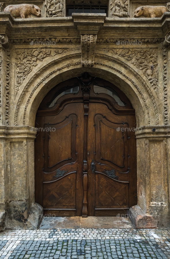 Medieval oak wood door in the old town center of Prague - Stock Photo - Images