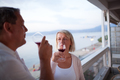 Couple Drinking Red Wine on Balcony of Beach Hotel - PhotoDune Item for Sale
