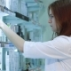 Woman Standing In Pharmacy Drugstore - VideoHive Item for Sale