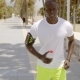 Young Man Listening To Music As He Goes Jogging - VideoHive Item for Sale