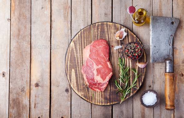 Raw fresh meat steak on cutting board. Copy space. Top view - Stock Photo - Images