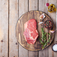 Raw fresh meat steak on cutting board. Copy space. Top view - PhotoDune Item for Sale