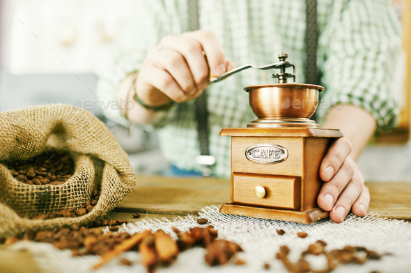 Grinding fresh beans - Stock Photo - Images