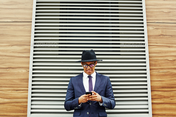 Businessman with mobile phone - Stock Photo - Images