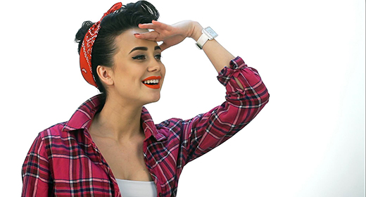 Beautiful young woman with pin-up make-up and hairstyle posing