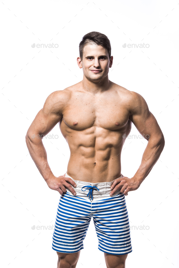 Sexy athletic man showing muscular body and sixpack abs, isolated over white background. Strong male - Stock Photo - Images