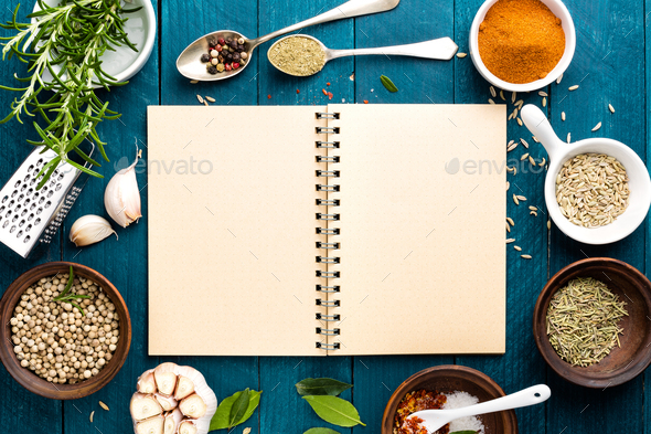 culinary background and recipe book with various spices on wooden table - Stock Photo - Images