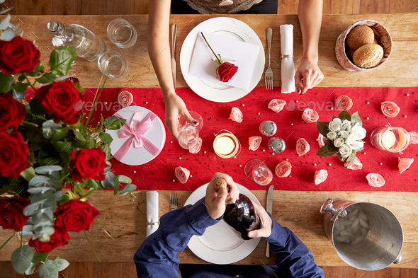 Overhead View Of Romantic Couple At Valentines Day Meal - Stock Photo - Images