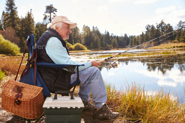 Senior man fishing in a lake, Big Bear, California, close-up - Stock Photo - Images