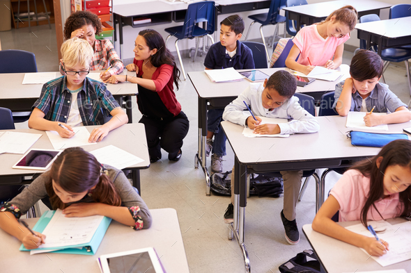 Elevated view of teacher and kids in elementary school class - Stock Photo - Images