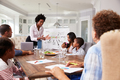 Businesswoman presents meeting to a family in their kitchen - PhotoDune Item for Sale