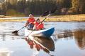 Father and son kayaking on lake, California, USA - PhotoDune Item for Sale