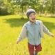 Young Kid Running and Smiling in the Park - VideoHive Item for Sale