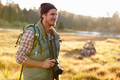Man Hiking with camera in countryside - PhotoDune Item for Sale