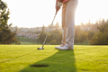 Close Up Of Male Golfer Lining Up Putt On Green - PhotoDune Item for Sale