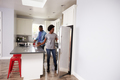 Young Couple Relaxing In Apartment Kitchen Together - PhotoDune Item for Sale
