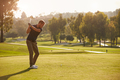 Male Golfer Lining Up Tee Shot On Golf Course - PhotoDune Item for Sale