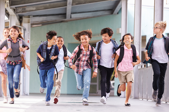 258c1e73239 Group of elementary school kids running in a school corridor - Stock Photo  - Images