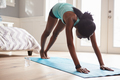 Young black woman in the downward-facing dog yoga pose - PhotoDune Item for Sale
