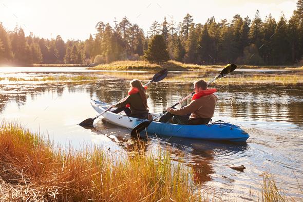 Couple kayaking on lake, back view, Big Bear, California - Stock Photo - Images