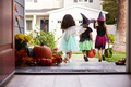 Three Children In Halloween Costumes Trick Or Treating - PhotoDune Item for Sale