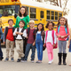 Teacher and a group of elementary school kids at a bus stop - PhotoDune Item for Sale
