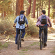 Gay Male Couple Cycling Through Fall Woodland - PhotoDune Item for Sale
